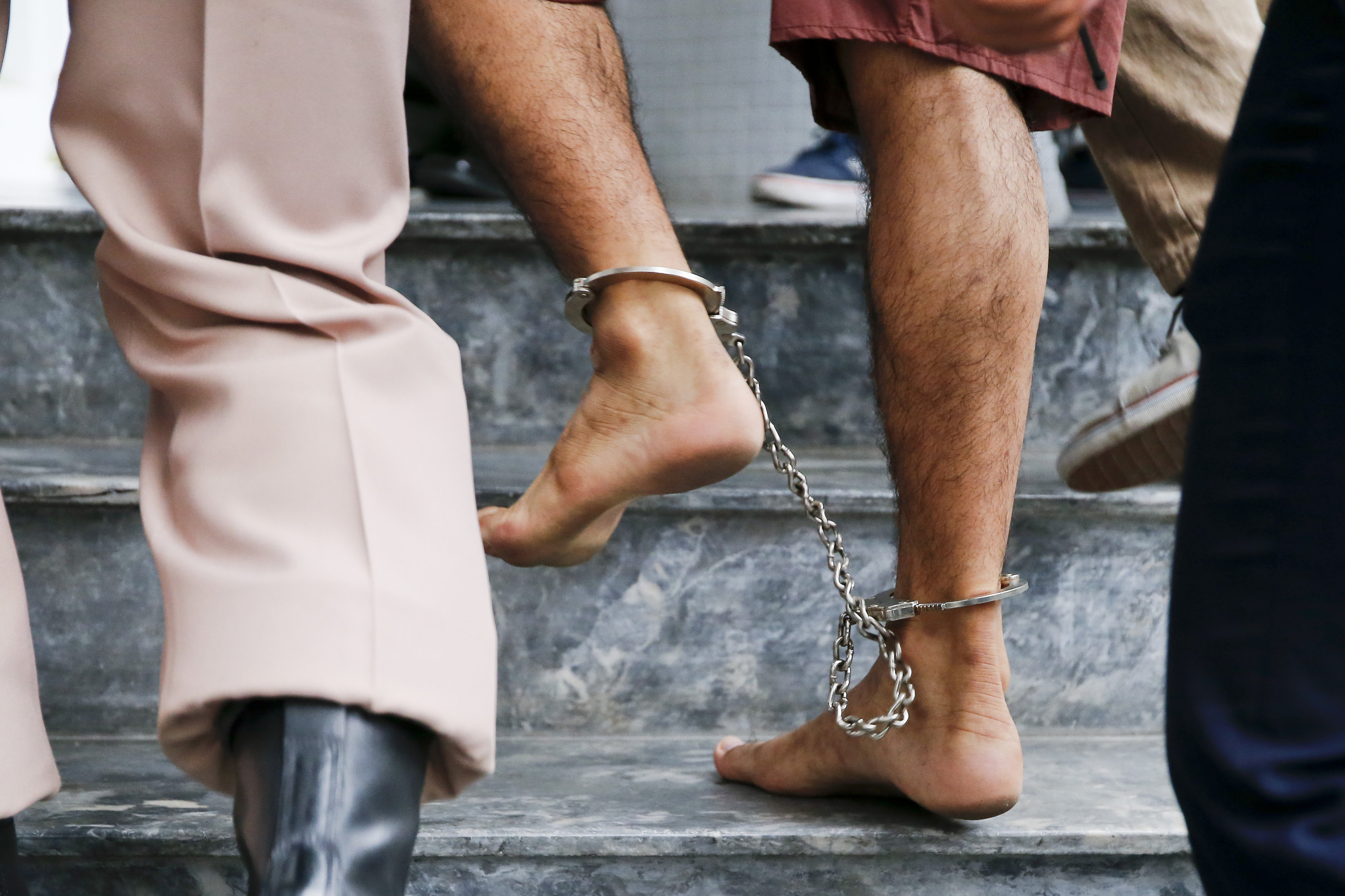 The shackled feet of a bombing suspect in Bangkok, Thailand, are seen as he is escorted by officers and prison personnel to Military Court Feb. 16. Pope Francis asks world leaders for a Jubilee Year moratorium on the death penalty. (CNS photo/Diego Azubel, EPA)  See POPE-ANGELUS-DEATH-PENALTY Feb. 22, 2016.