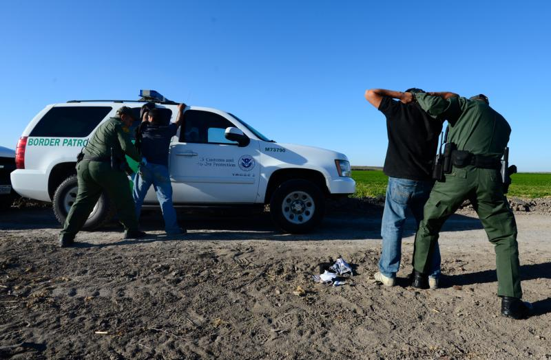 "U.S. Border Patrol agents apprehend and search two people in 2013 who were suspected of entering the U.S. illegally by crossing the Rio Grande River near McAllen, Texas. In a joint statement, Catholic bishops whose dioceses are along the U.S.-Mexico border called for respecting people's dignity regardless of ""migration condition."" (CNS photo/Larry W. Smith, EPA) See BORDER-BISHOPS-IMMIGRATION Feb. 16, 2017."