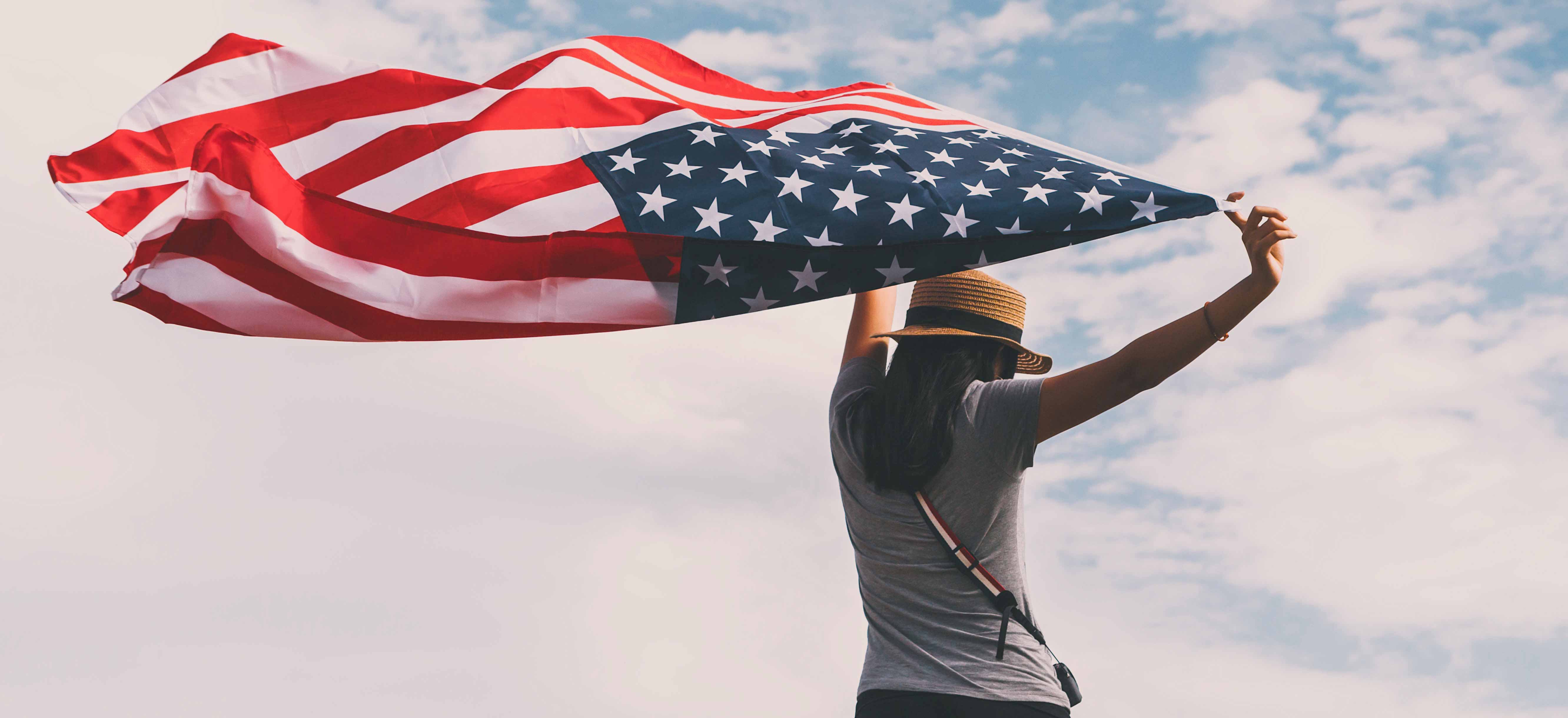 Young-Woman-Holding-American-Flag-cropped